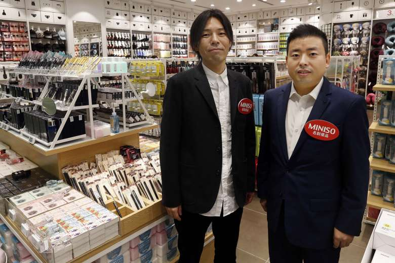 Junya Miyake (Founder/chief designer: left) and Ye Guo Fu (Miniso president). Photo:    MINISO LIFESTYLE SOUTH AFRICA   . Some claim Mr. Miyake is a hired figurehead from Japan to lend credibility to Miniso's 'Japanese Lifestyle' claims.