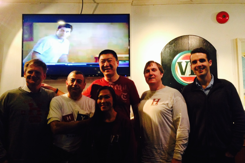Harvard alums basking in victory at the Camel Sports Bar in Shanghai.