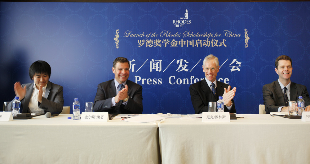 Harvard Club of Shanghai Board member Meijie Tang, AB '09 (far left) at the press conference