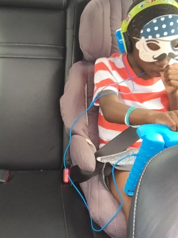Tisetso enjoying being a pirate and watching Harry Potter/Ben 10 while driving home.