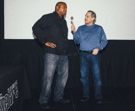 Former Seahawks player Mack Strong speaking with host Mike Brown at the Cinebarre.