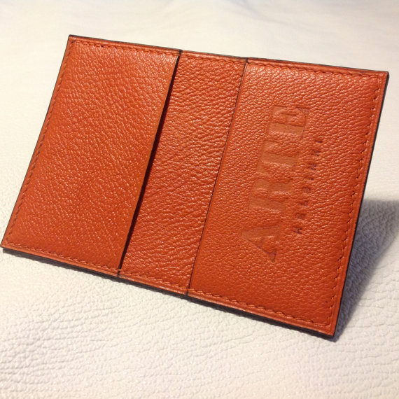 Orange chevre wallet.