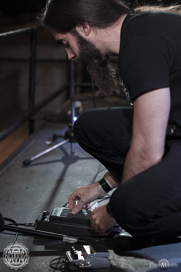 Telis Mimoglou, guitarist and vocalist setting up his gear.