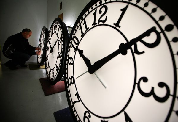PHOTO: National Geographic -  news.nationalgeographic.com    Photo of a man adjusting giant clocks. Peter Shugrue checks a clock at the Electric Time Company factory in Medfield, Massachusetts, on March 8, 2013.