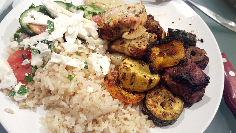 TOSA All-purpose Kebabs! With brown rice, cucumber tomato salad and goat cheese.