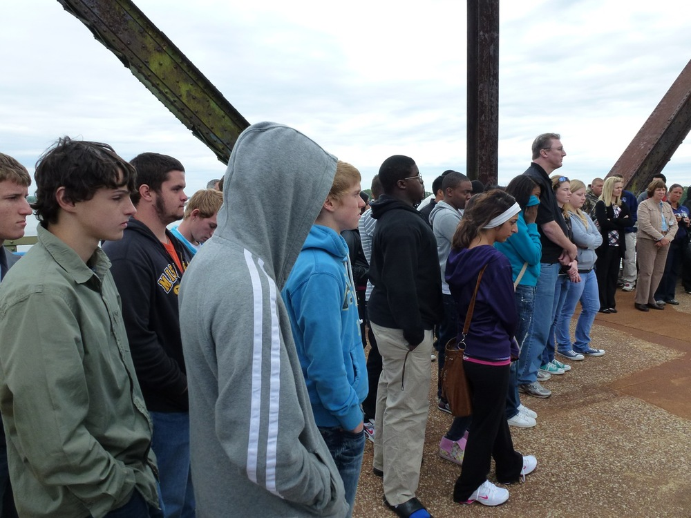 Gathering on the bridge for the installation of the memorial plaque, 2011.