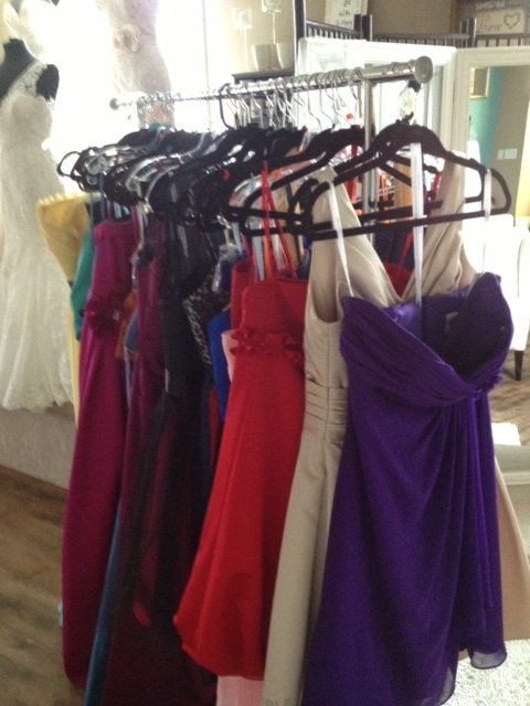 Packing up bridesmaids gowns - the end of an era at Once Upon A Time Weddings.