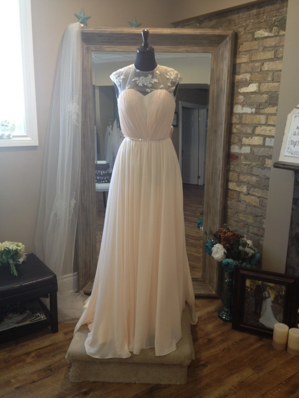 This flowy chiffon gown is perfect for a summer wedding.  With just a touch of lace & adding a touch of sparkle, you combine comfort with elegance.  This gown is sold exclusively at Once Upon A Time Weddings.