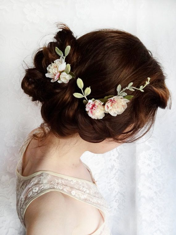 This updo with a few small flowers is the perfect summer wedding hairstyle.