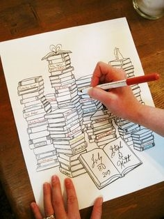 How perfect is this guest book alternative?  Get your guests to sign a spine of a book that you can frame and keep.