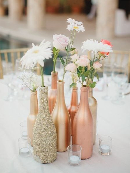 Collect wine bottles from family + friends and spray paint them, super affordable and chic!