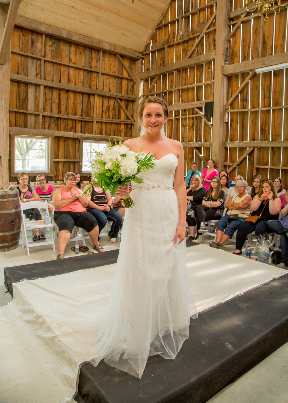 Kristy was so excited to get to wear her actual wedding gown again!  She got married last summer in this beauty!