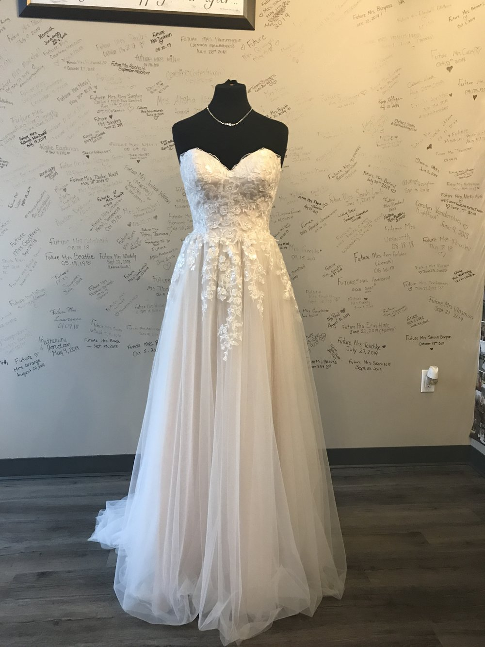 This beautiful gown from our store would be perfect for a romantic themed wedding. It has the perfect soft sparkle throughout the lace with beautiful, flowy tulle skirt. We also love the soft blush colour under the gown. It's perfect for that romantic look.