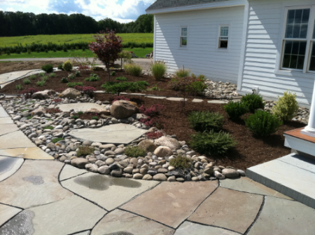Formal Irregular flagstone walkway, rock garden and plantings installed in Cortland, NY.