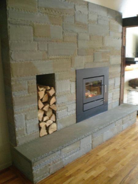 This is A fireplace that GreenScene faced with a bluestone veneer. It was Installed in Ithaca, NY