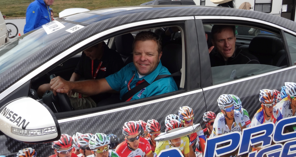Ride in a VIP caravan car alongside the peloton during the USA Pro Challenge. Photo by Pedal Dancer.