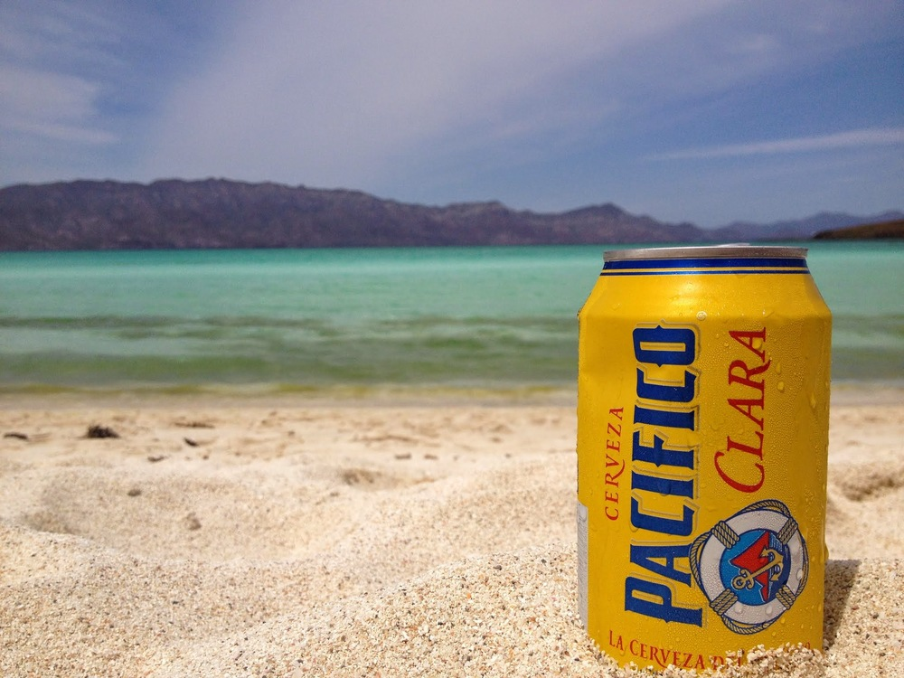 A fresh Pacifico, fish tacos and the warm sand.