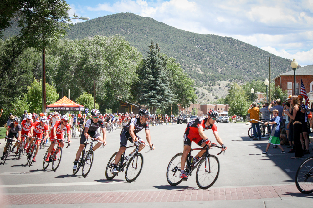 USA Pro Challenge cyclists racing through downtown Salida.