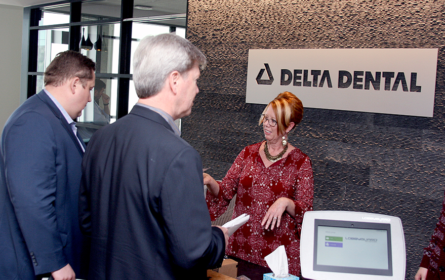 WSDA President Dr. Bernard J. Larson and Executive Director Bracken Killpack hand deliver signed petitions to Delta Dental of Washington's new South Lake Union headquarters on Monday, June 19.