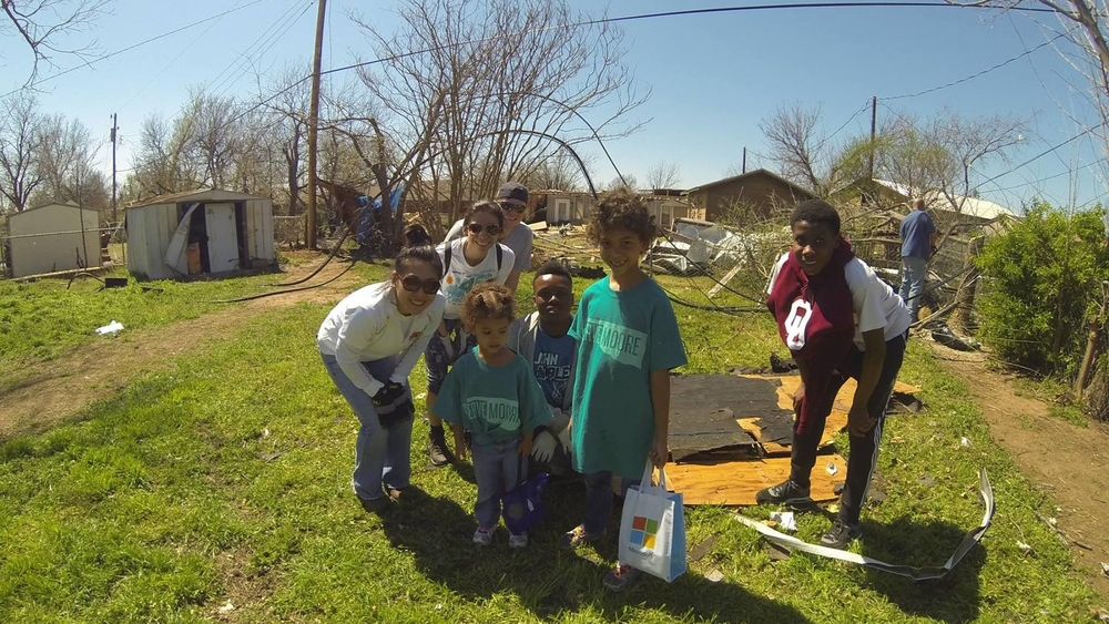 Jaycen (7) and Zaria (3), along with parents Corey and Alissa, hand out water and cookies to Serve Moore volunteers responding to the March 2015 EF-2 tornado in Moore, OK. Their family home was destroyed in the May 2013 EF-5 tornado also in Moore.