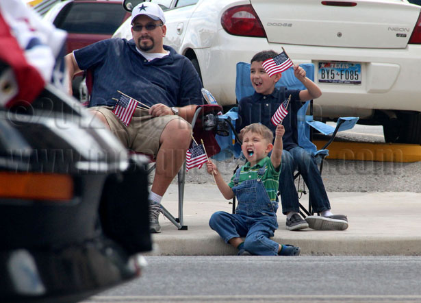 Matthew Juarez, 3, and Jonathan Juarez, 7, cheering as the parade continued with dad Adrian Juarez at the Veteran's Parade on Nov. 10 at Avenue E and Third Street. Photos by Ava Bustos