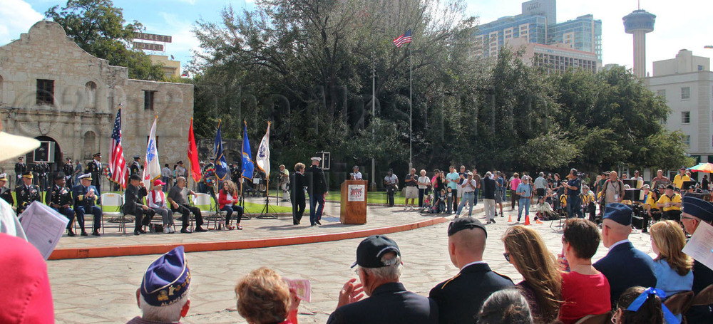 President Delia Guajardo is escorted by Maj. Martin Gale of the United States Marine Corps to the podium to thank and congratulate the soldiers who have have served in the military at the Veterans Day ceremony Nov. 10 in front of the Alamo.