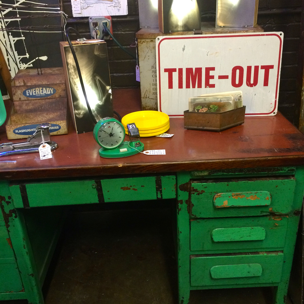 This bright, green desk looks like it's been through a tumble or two, which is what I love about it. The wood top is in perfect condition, so it's a good buy in my book.