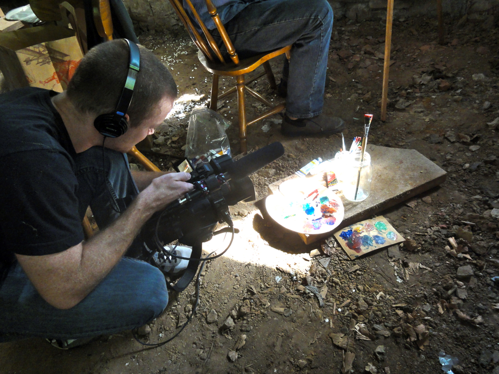 My friend catching that perfect shot of dust and light hitting the paint brushes and palette.
