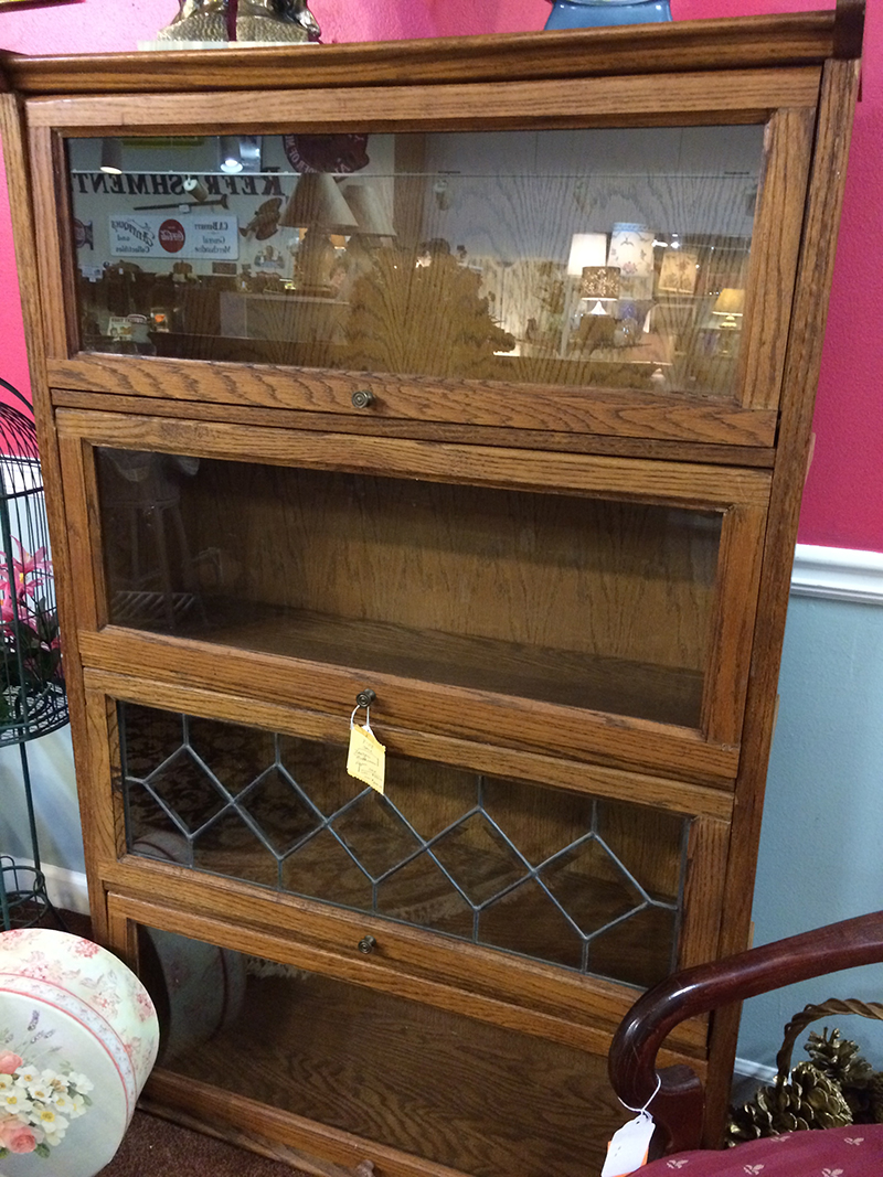 I'm a sucker for barrister bookcases, and this one was reasonably priced compared to others I've seen. It may not be quite as 'antique' but it still had the look and feel of that style bookcase and I'm a sucker for storage.