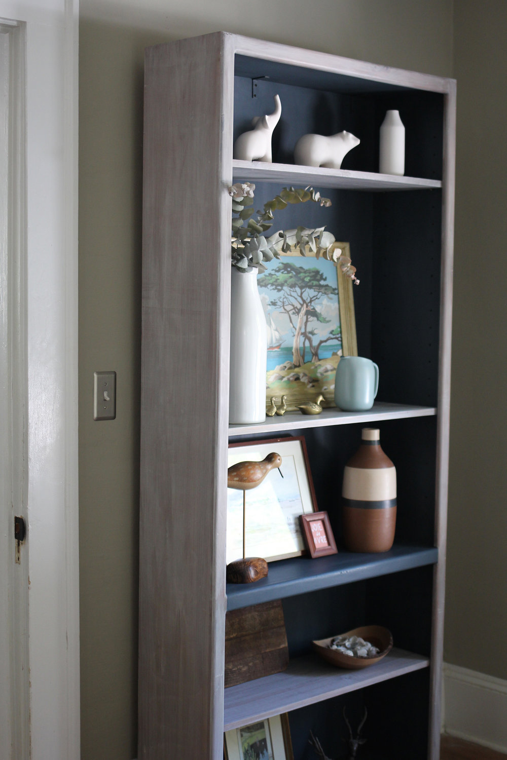 jo-torrijos-a-simpler-design-atlanta-painted-furniture-custom-furniture-annie-sloan-white-washed-bookcase-navy-8.jpg