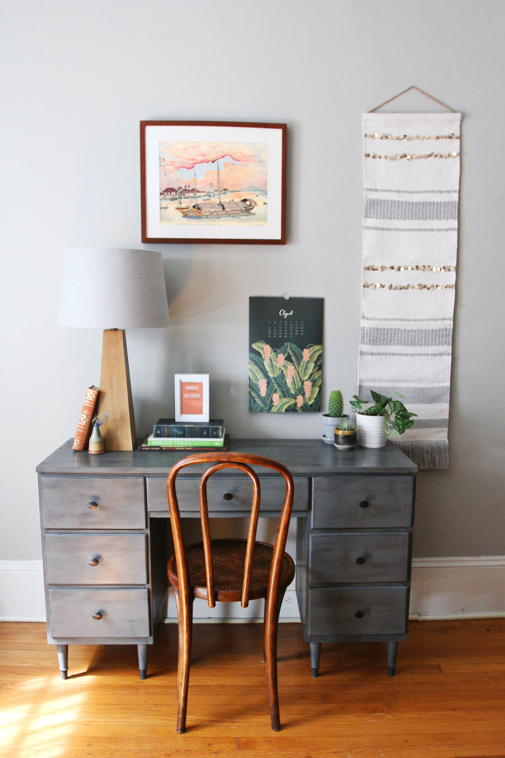combining mid century and industrial gray desk with brushed black