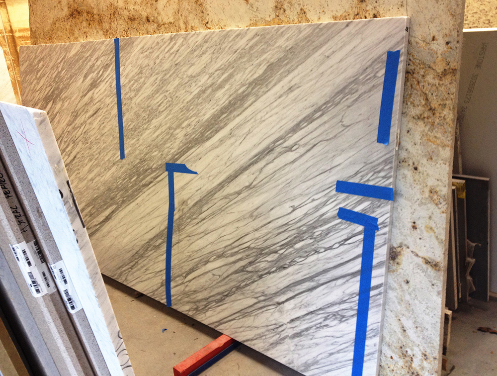Picking through a variety of slabs, looking at the color, grain, density, and type of stone.