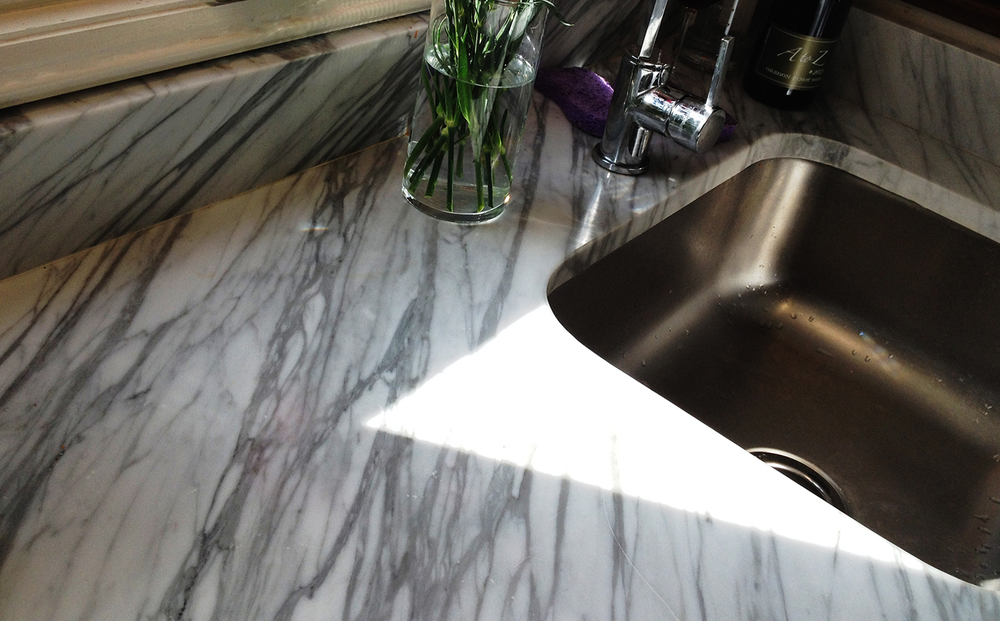 The counter and backsplash were taken from the same parts of the slab so the grain wraps up the edge.