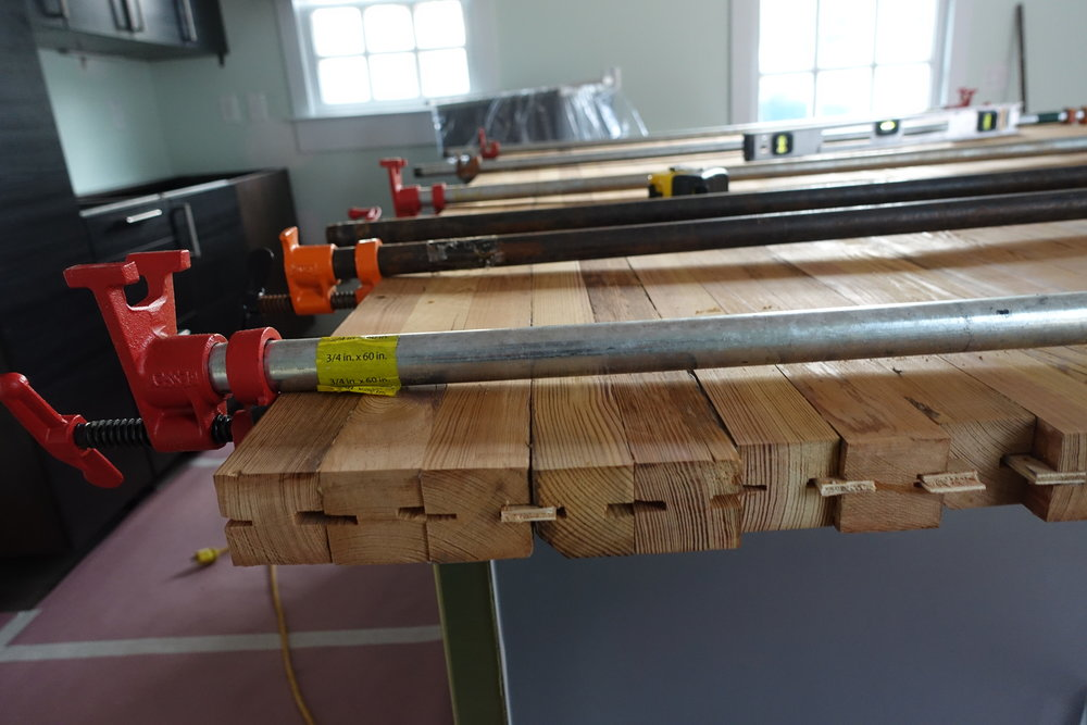 The ceiling joists were 100+ years old. The contractor ripped them to size, then glued them up