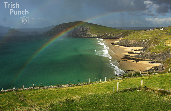Rainbow over Coumeenole beach on the Slea head drive on the Dingle peninsula in Kerry in Ireland.