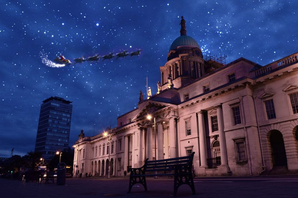 Santa and his reindeer fly over The Custom House.