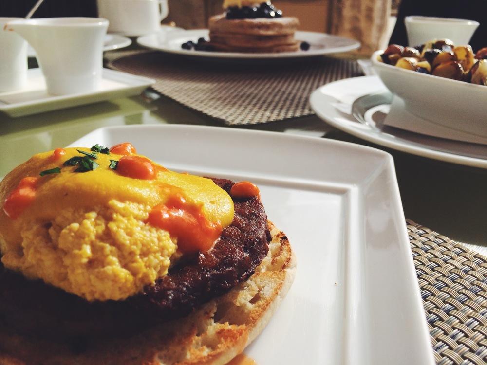 """eggs"" benedict - gardein sausage, scrambled tofu & yellow tomato hollandaise"