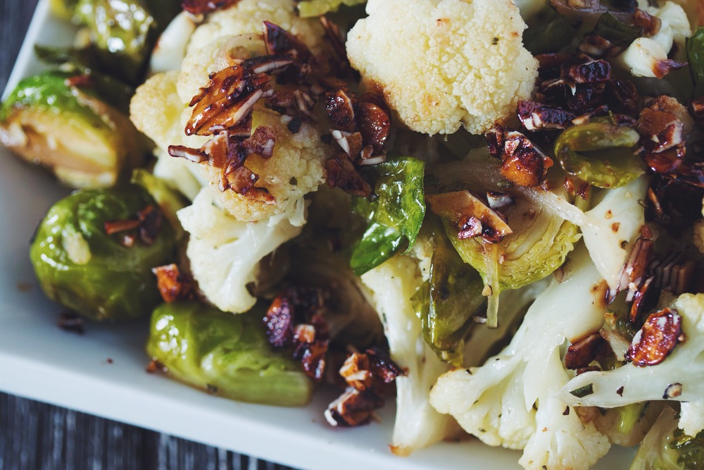 roasted brussels and cauliflower with smokey almond bits #vegan #christmasrecipes | RECIPE on hotforfoodblog.com