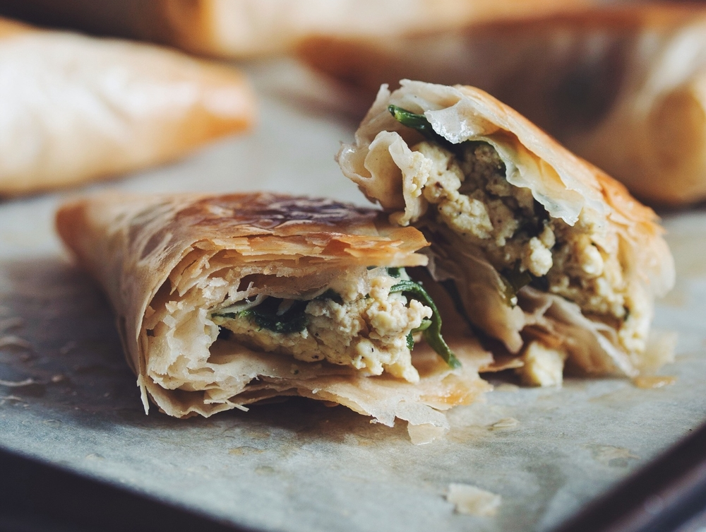 spinach & feta phyllo triangles #vegan | RECIPE on hotforfoodblog.com