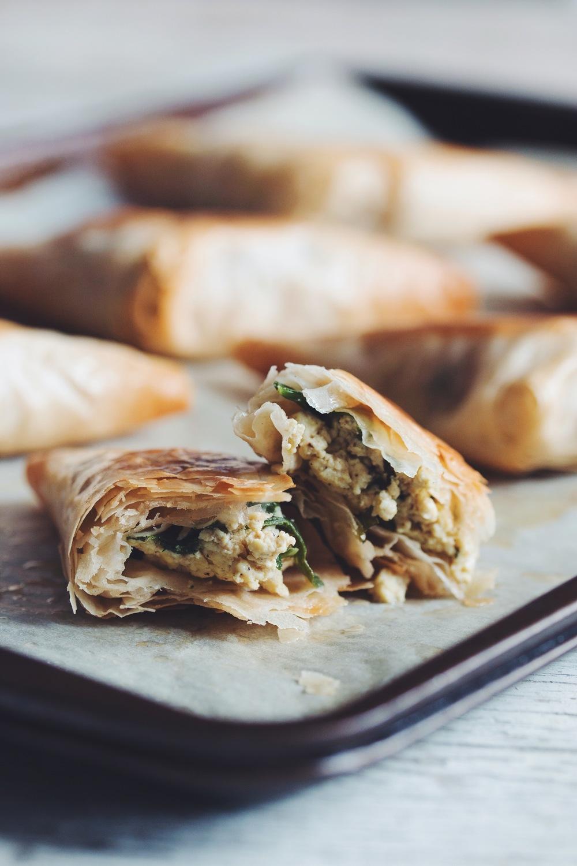 spinach & feta phyllo triangles #vegan | RECIPE on hotforfoodblog.com