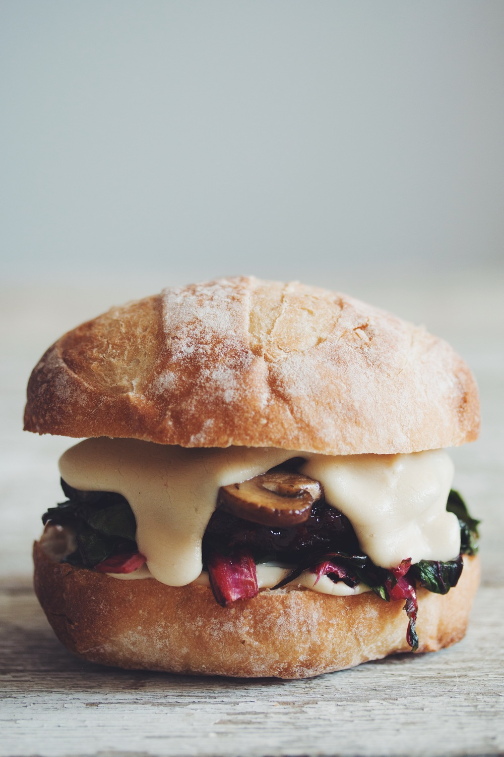 smoked gouda mushroom chard burger #vegan | RECIPE on hotforfoodblog.com