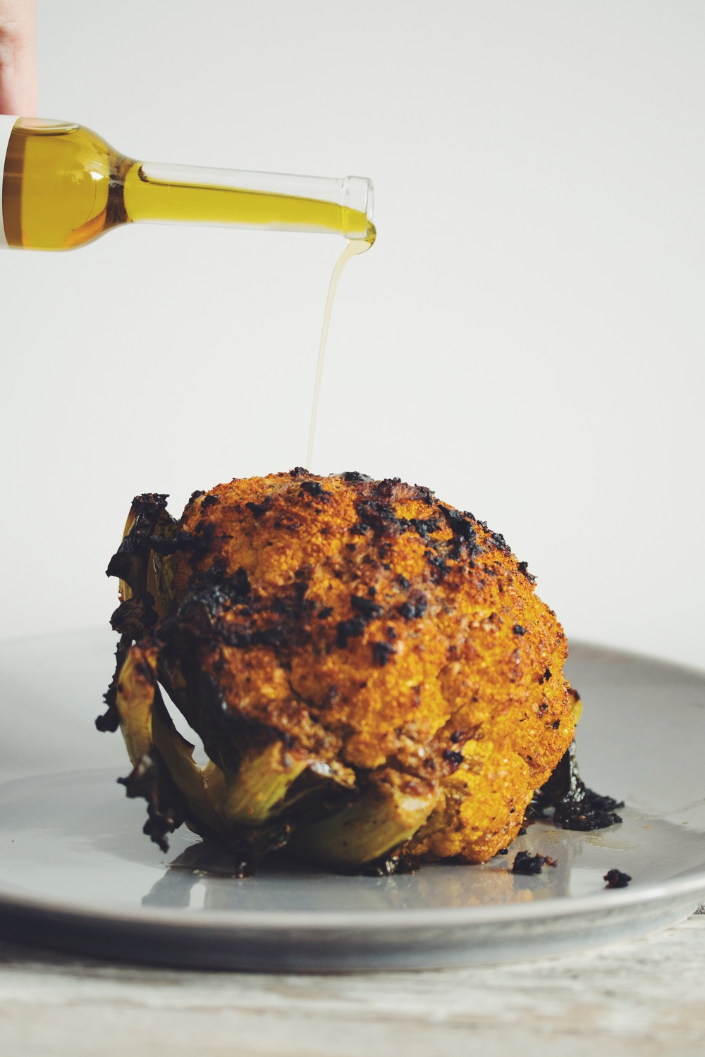 how to roast a whole cauliflower | RECIPE on hotforfoodblog.com