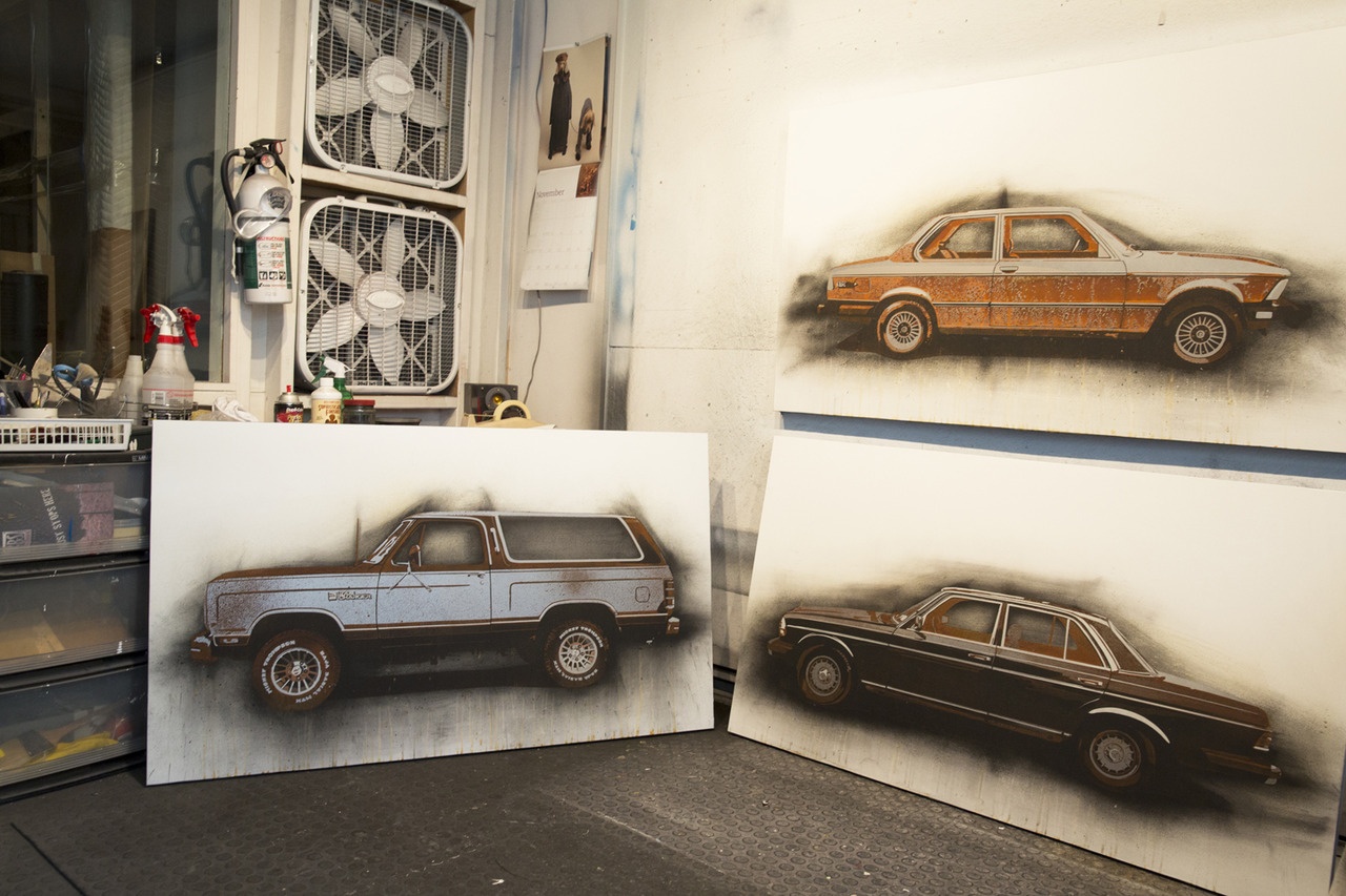 "New Car Paintings in the Studio. 28""x48"", Rust, Charcoal and Enamel on Steel panel."