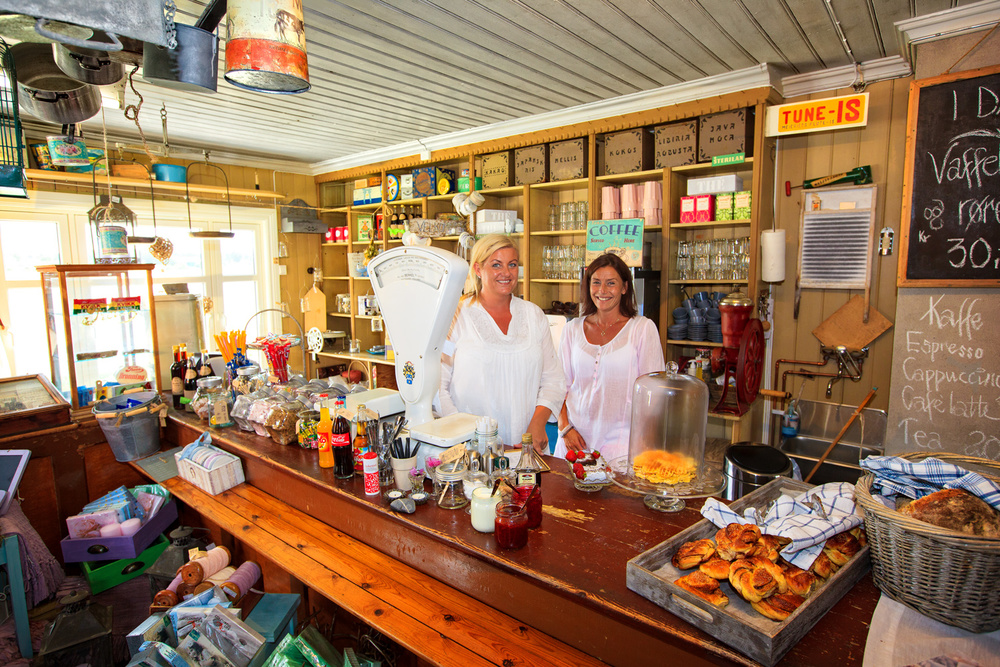"YOU ARE WELCOMED TO THE ISLAND HERFØL BY THE SCENT OF FRESH CINNAMON BUNS   AND TWO NICE WOMEN BEHIND THE COUNTER IN THE SUMMER-OPEN GENERAL STORE   ""PÅ POSTEN"". READ MORE ABOUT HERFØL ISLAND HERE."