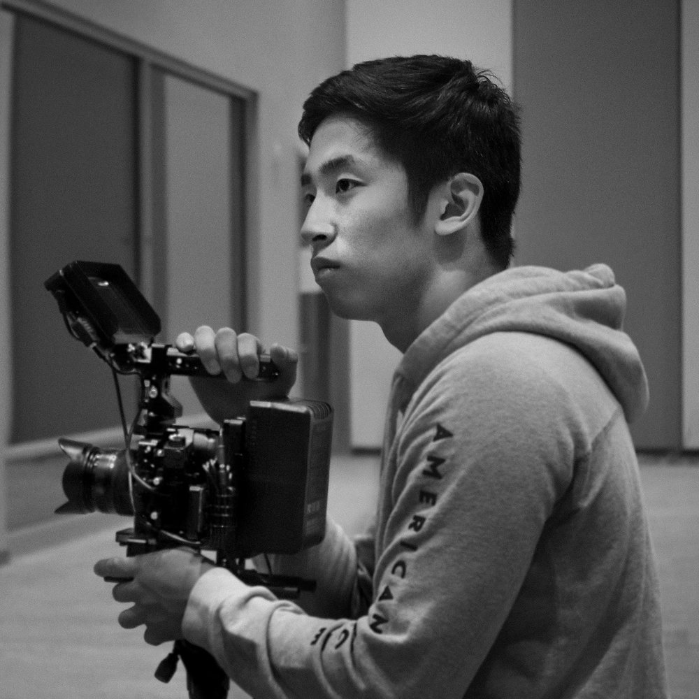 JiWon Baeq - Videographer   JiWon is a videographer and founder of G1 Studios LLC. He has experience in creating films for weddings, music videos, commercials/promos, and event coverage for independent artists and companies. While creating videos, JiWon is also pursuing a degree in Cinematic Arts and Philosophy at the University of Maryland, Baltimore County.