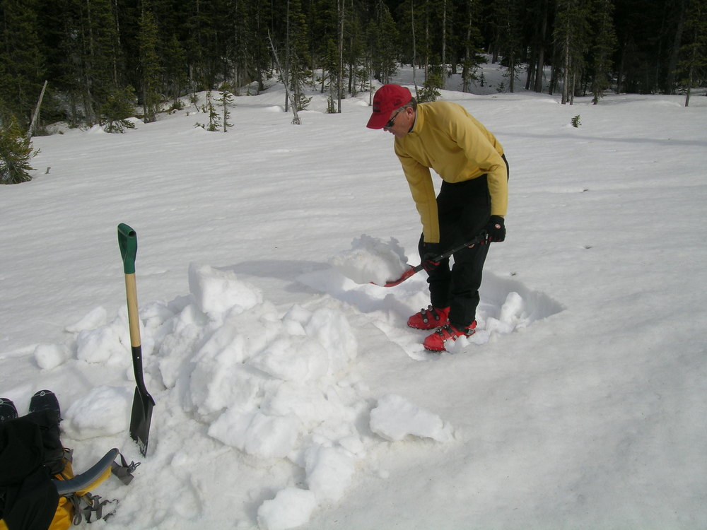 Chris Landry begins digging a pit at the Rabbit Ears Pass CODOS Site, April 10, 2012