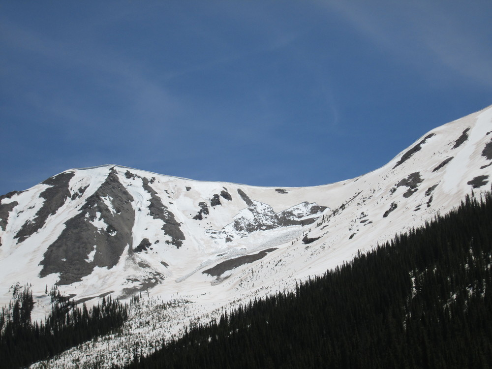 "A fresh ""wet slab"" avalanche was observed on a north aspect just above the ghost town of Independence.  High snowmelt rates produced by dust at the snowpack surface, and the resulting intense flux of free water into the snowpack structure, can contribute to this type of very dangerous spring avalanche activity."
