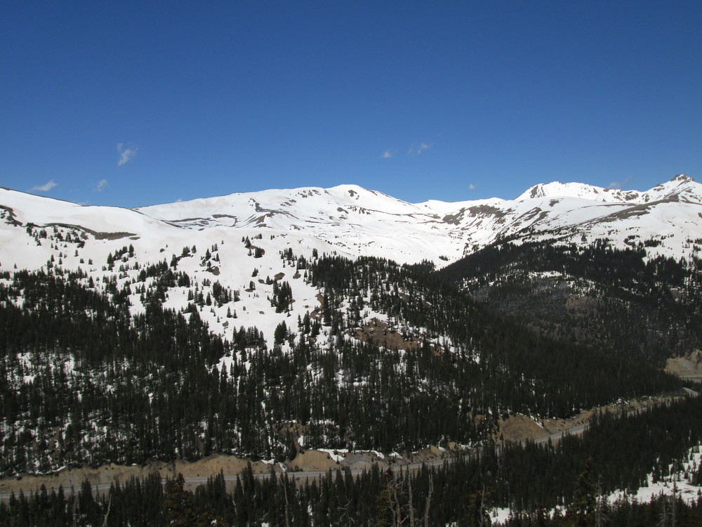 On the east side of Loveland Pass, snowcover reached to and sometimes just below treeline.  Dirty snow was also rapidly emerging as the Memorial Day layer of clean snow was quickly 'burning off', melted from above by direct solar absorbed in the clean snow surface and from below by solar energy that had penetrated the thinning clean snow layer and been absorbed in the underlying D8 dust layer beneath.
