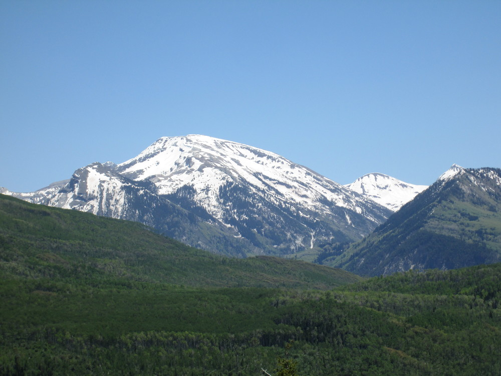 Considerable snowpack remained in alpine terrain in Yule Creek and other Crystal River headwaters, as seen from McClure Pass, and dust was rapidly emerging on even the highest north-facing slopes.