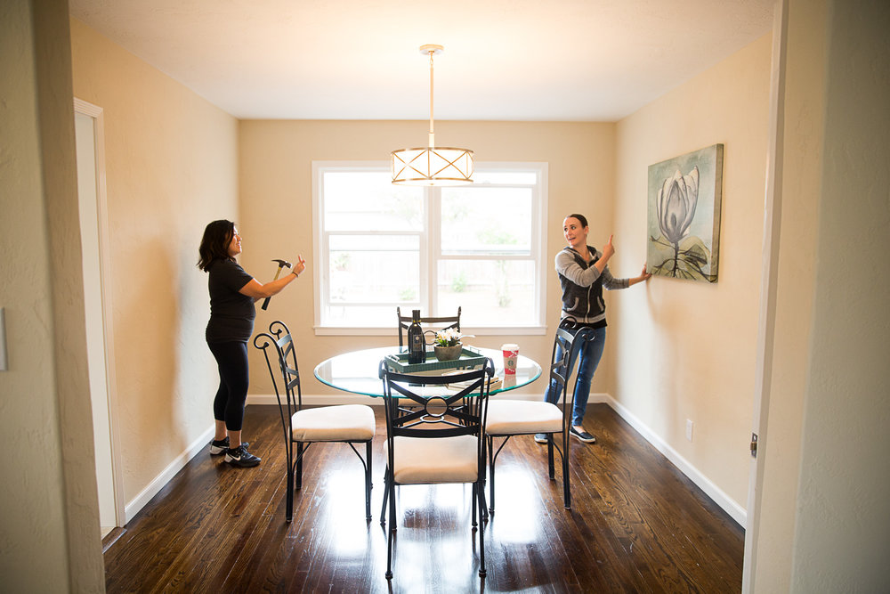 The professional stagers put the finishing touches on the home.